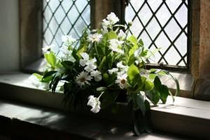 Sweet peas and garden daisys in Penshurst Church